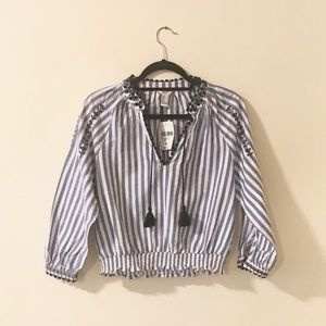 Blue and white striped blouse with embroidery